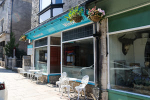 White metal tables & chairs on the street outside Tawny's wine bar in Swanage