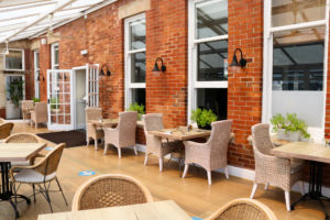Rattan dining furniture in the conservatory area, Swanage Grand
