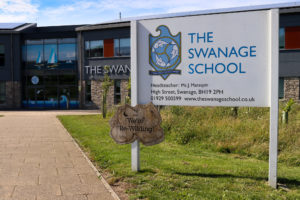 Swanage School sign along entrance path