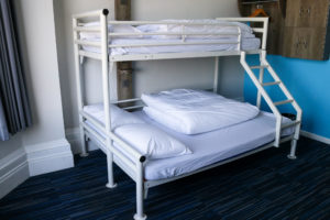 Double and single bunk bed at YHA Swanage