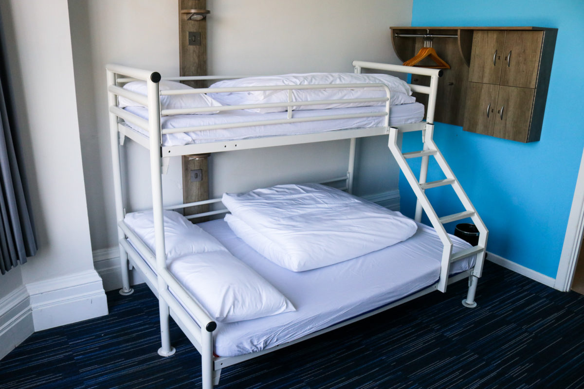 Double and single bunk beds in family room at YHA Swanage