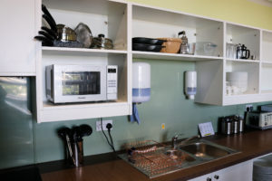 Sink, microwave and baking items, YHA Swanage self-catering