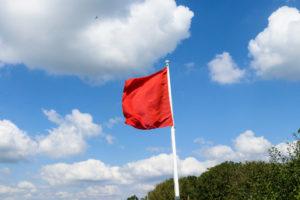 Red flag warning sign - walking prohibited on Lulworth Range walks