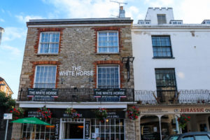 Hanging baskets outside the White Horse pub in Swanage