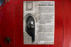 Welcome message and history behind message on the door of Tyneham Church