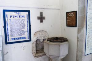 Old piscina stone basin in the church at Tyneham Village