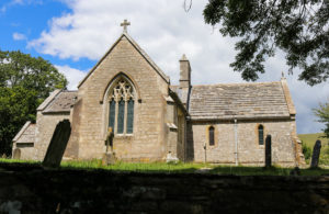 Side view of St Mary's Church & graveyard in Tyneham village
