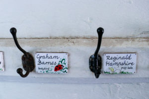 Children's pegs on the wall at Tyneham school exhibition