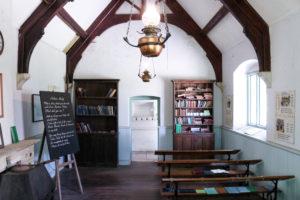 Bookcases, desks and blackboard in the Tyneham School exhibition