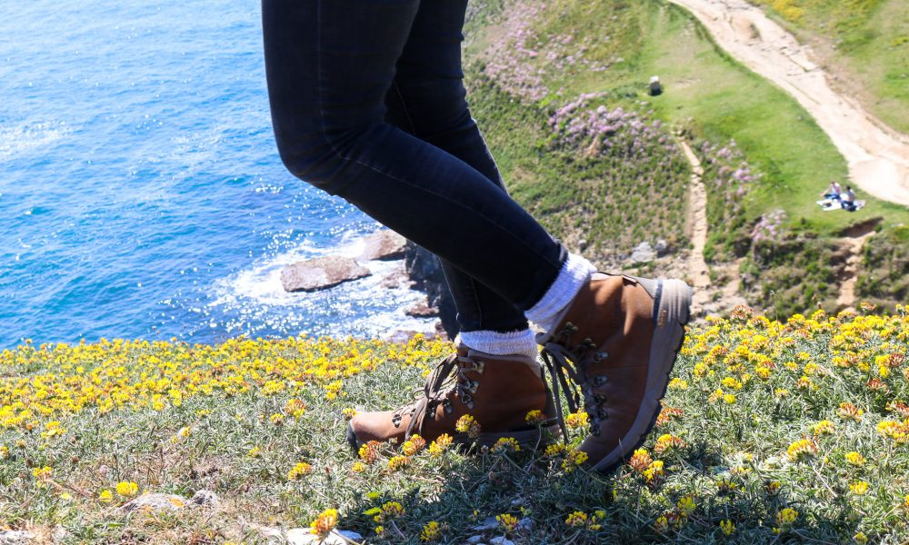Walking boots on the cliff at Durlston Country Park