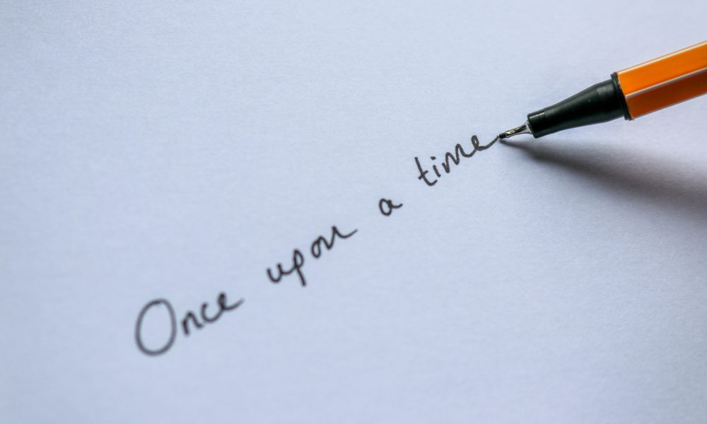 Once upon a time being written with a pen