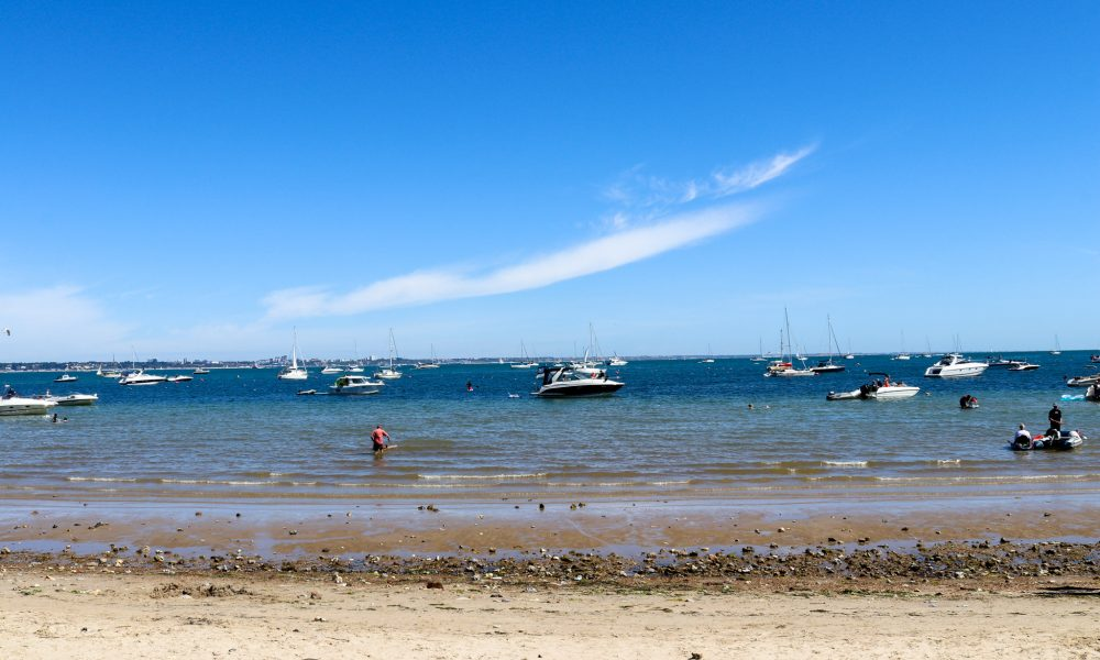Boats in the sea at Studland's South Beach