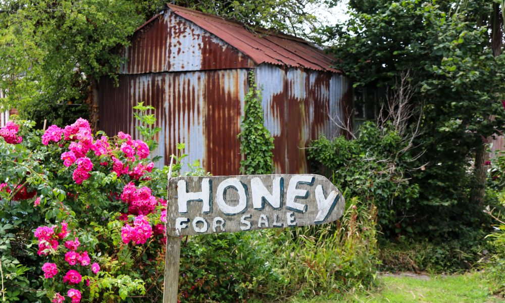Honey for Sale sign by shed in Harman's Cross