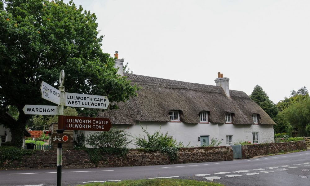 East Lulworth thatched cottage and sign