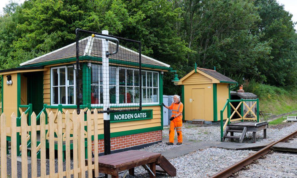 Workman at Norden railway station