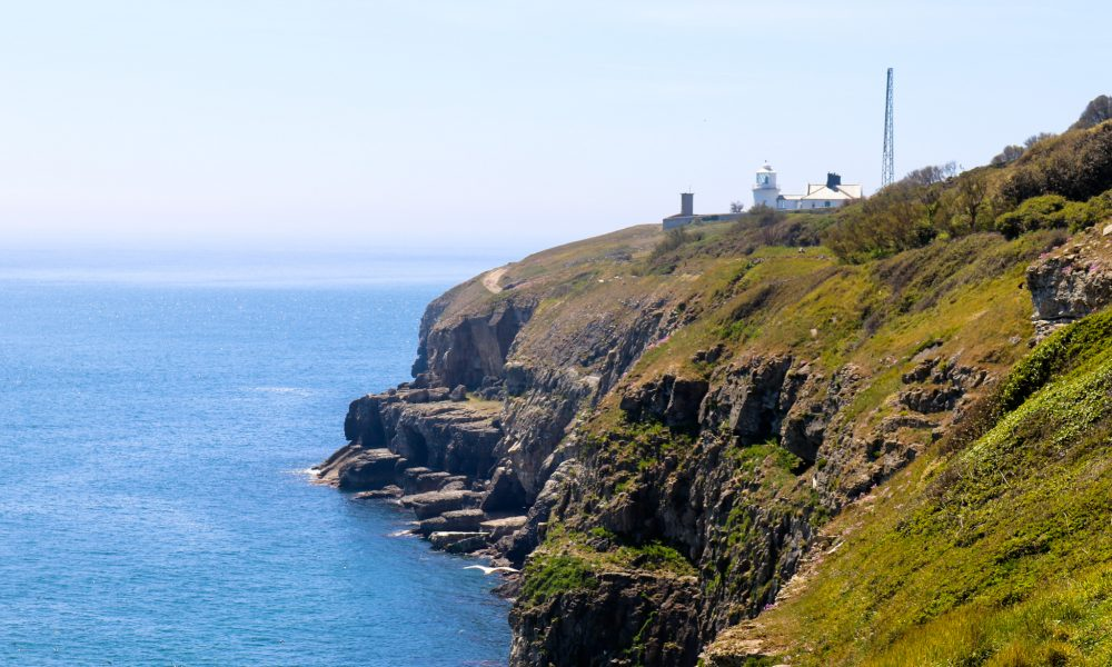 Headland at Durlston showing lighthouse