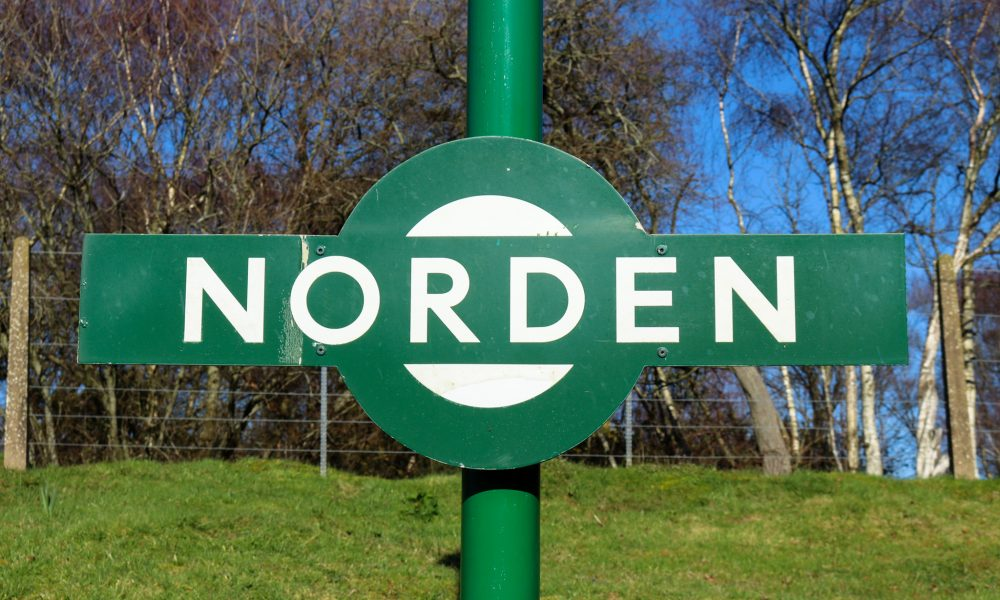 Green and white sign for Norden railway station near Corfe Castle