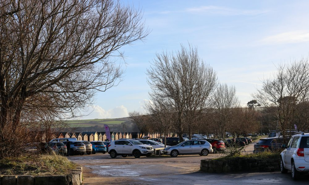 Cars parked at Knoll Beach car park in Studland