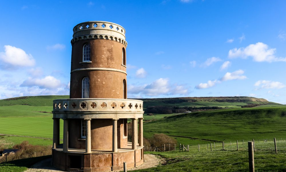 Clavell Tower in Kimmeridge with hills and farmland behind