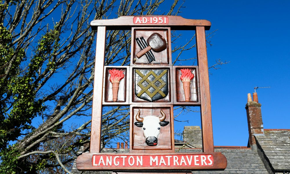 Painted wooden sign for Langton Matravers village