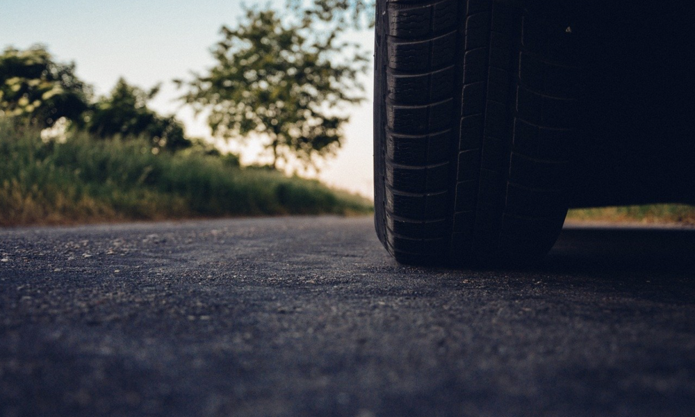 Wheel of a car driving along a road