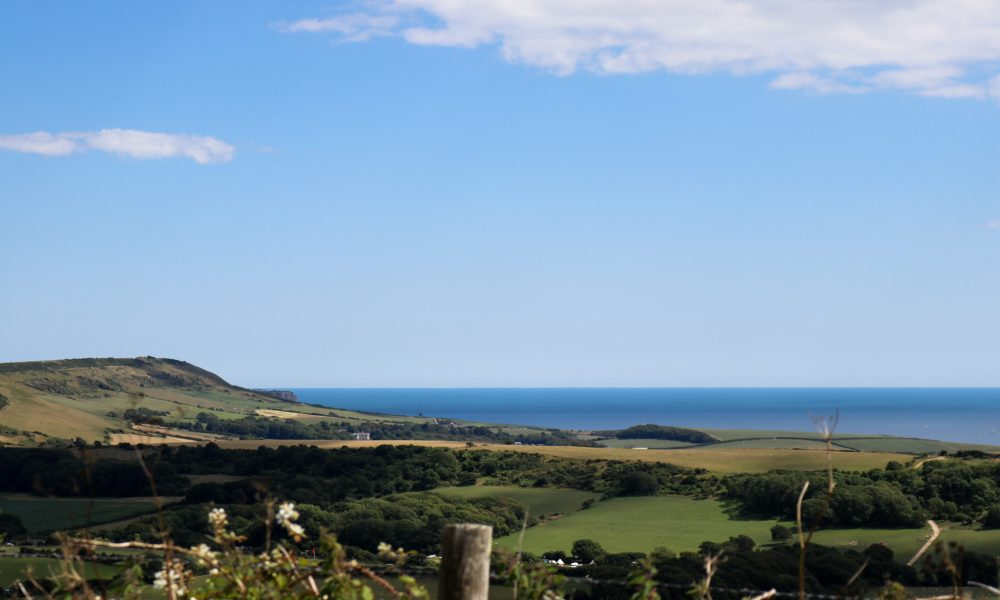 View of land and sea from Purbeck Hills near Grange Arch and Tyneham