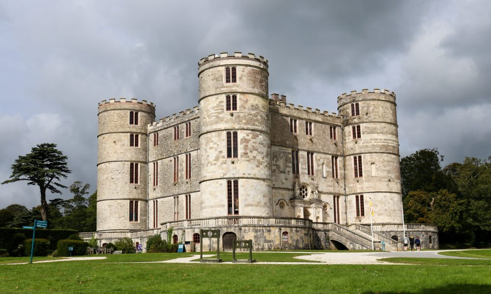 Stocks outside Lulworth Castle with cloudy sky