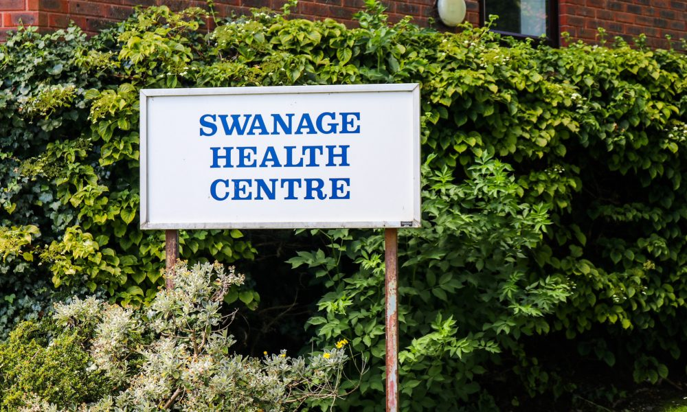 Sign outside the Swanage Medical Centre