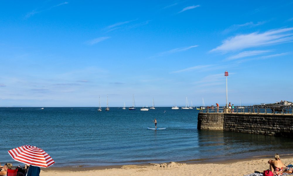 Paddle boarder in the sea at Swanage Beach